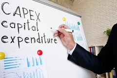 woman writing capex on a whiteboard